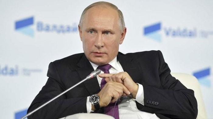 Putin dials up anti-US rhetoric, keeps mum on re-election