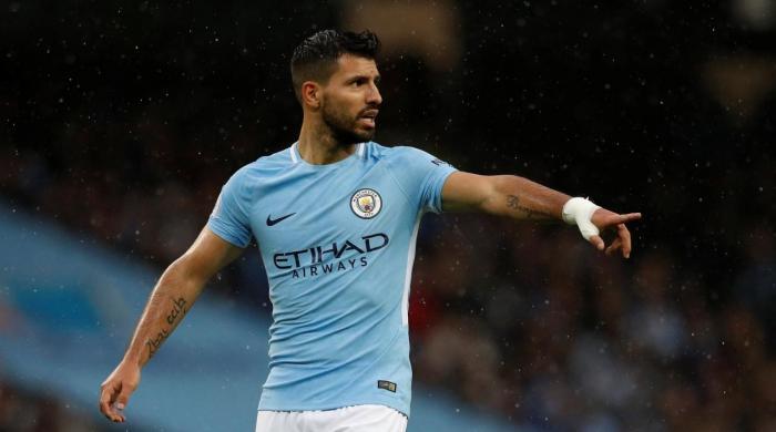 Aguero's milestone goal leads Man City to easy win