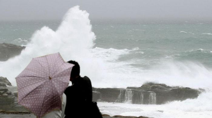 Powerful typhoon drenches Japan, tens of thousands advised to evacuate