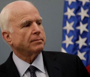 McCain takes swipe at Trump military service record