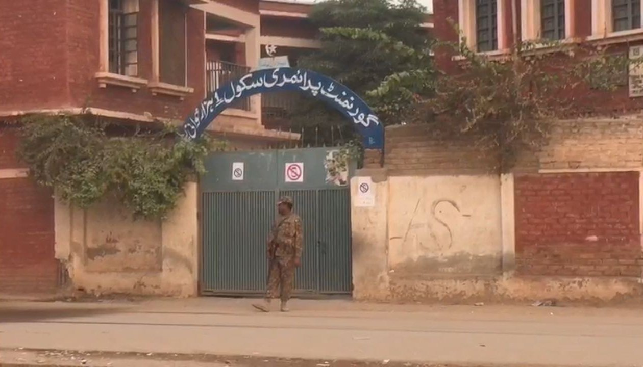 Security official at a polling station after voting concluded in NA-4 - Geo News