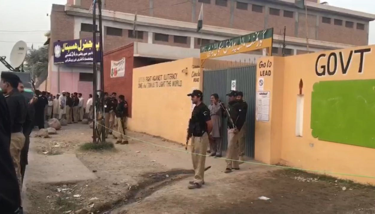Policemen guard a polling station after voting concluded in NA-4-Geo News