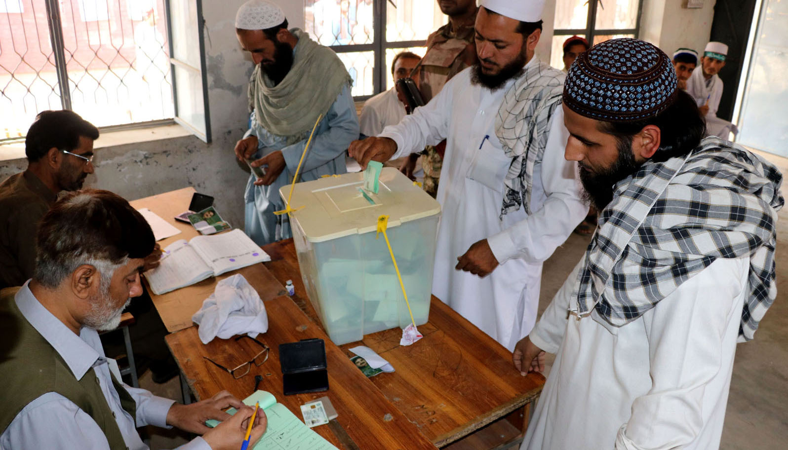 Male voter polling their vote at Polling Station during by-election in NA- 4 - INP