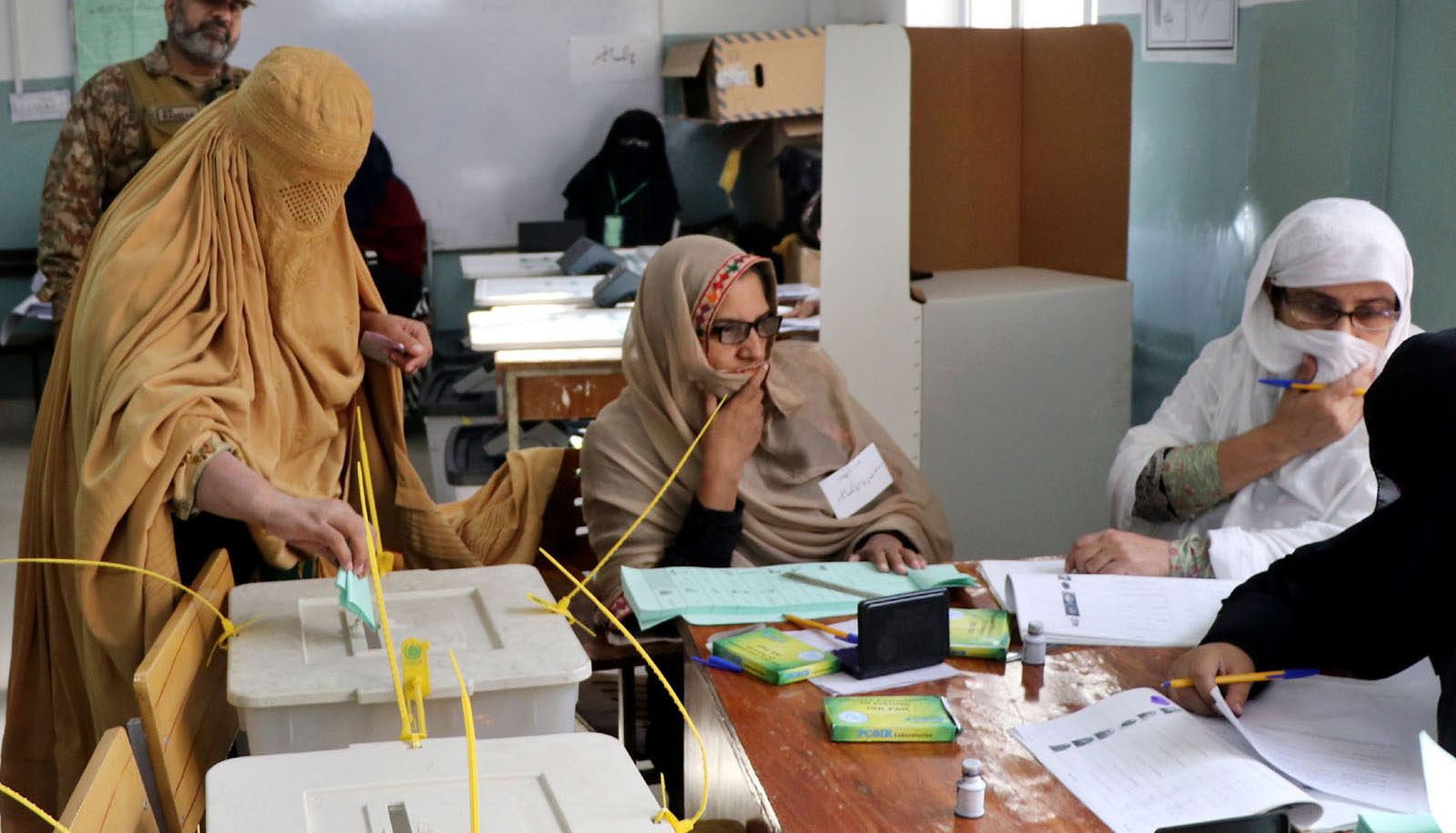 Female voter polling her vote at Polling Station during by-election in NA- 4 - INP