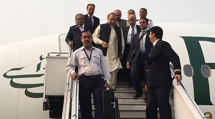 Nawaz Sharif returns to Pakistan, receives court summons by NAB
