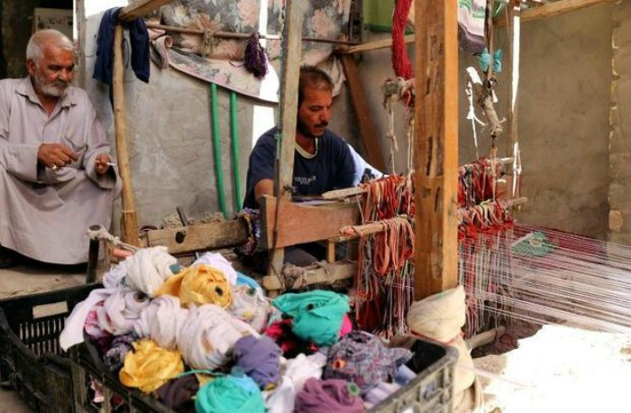 The carpet weavers say people use to come from abroad to place orders -- before the US-led invasion of Iraq in 2003-AFP