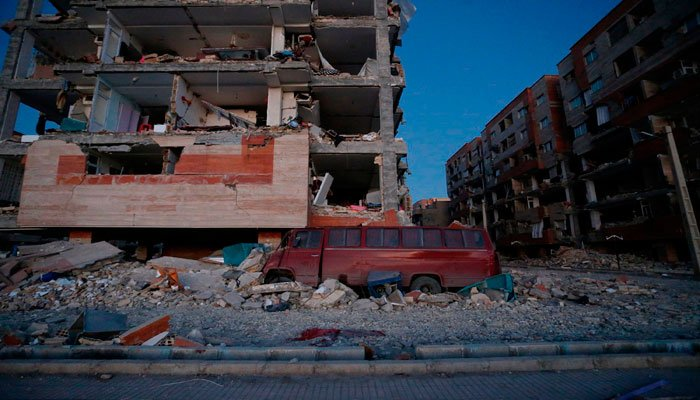 A damaged van and buildings are seen following the earthquake in Iran. Photo: AFP