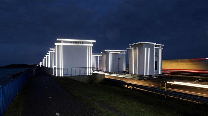 Art project lights up iconic 85-year-old Dutch dyke