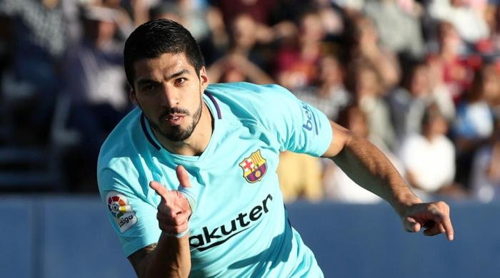 Suarez double stretches Barca´s La Liga lead