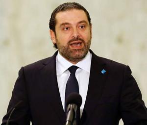 Lebanon's Hariri says to hold off resignation as PM