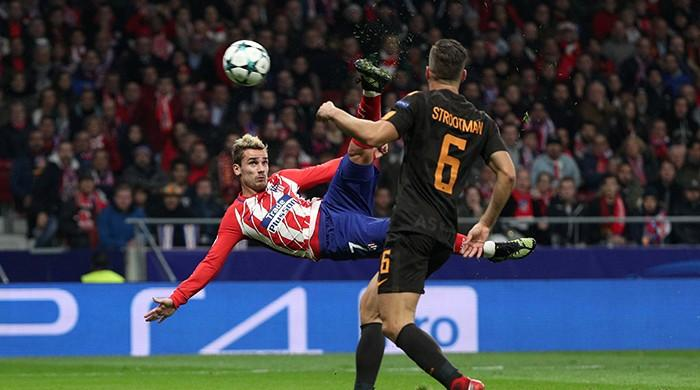 Griezmann stunner helps keep Atletico Champions League hopes alive