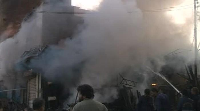 Firefighters douse fire at wood market in Karachi