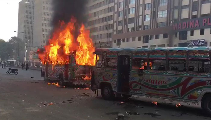 Two buses torched in Karachi after girl dies in road accident