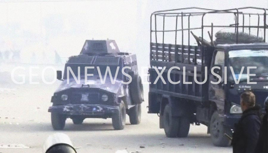 Armoured vehicles and prison vans arrive at the scene of an operation being carried out by the law enforcement agencies at Faizabad Interchange, Islamabad, Pakistan, November 25, 2017. Geo.tv via Geo News