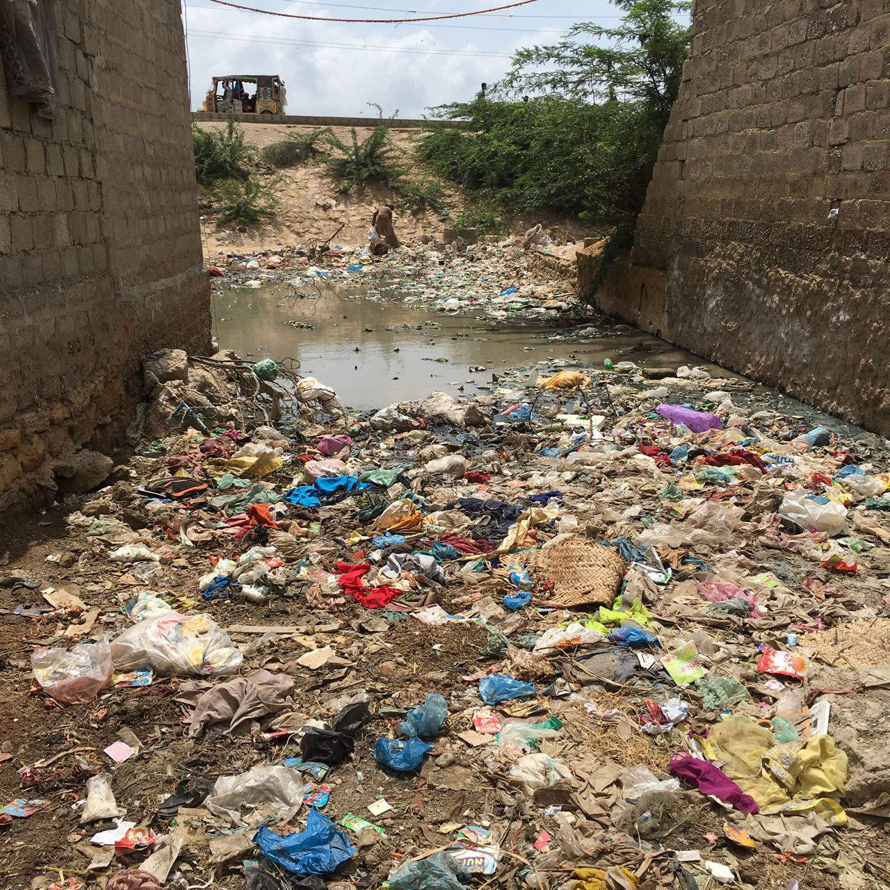 A lane turned into an open garbage dump in Karachi's Arkanabad neighbourhood.