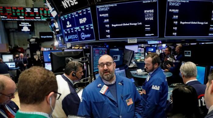 Stocks gain, dollar hits two-week high as risk appetite returns