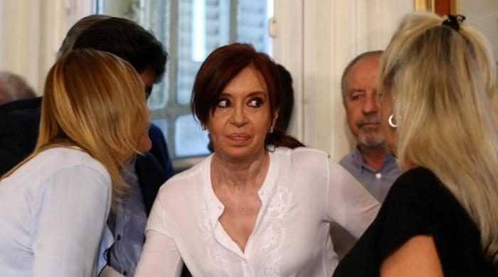 Argentina's ex-president charged with treason, arrest sought