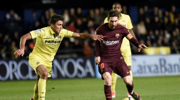 Suarez, Messi maintain Barcelona's La Liga lead