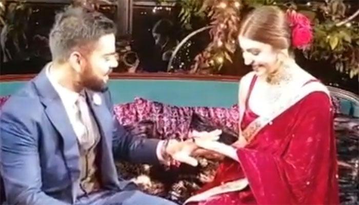 Anushka Sharma and Virat Kohli i- reception's invitation card at New Delhi