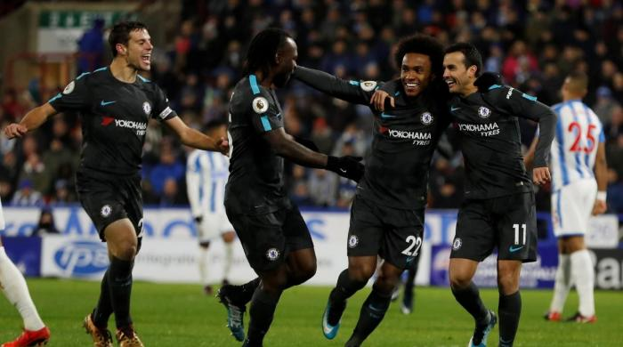 Chelsea cruise to 3-1 victory at Huddersfield, Burnley go fourth