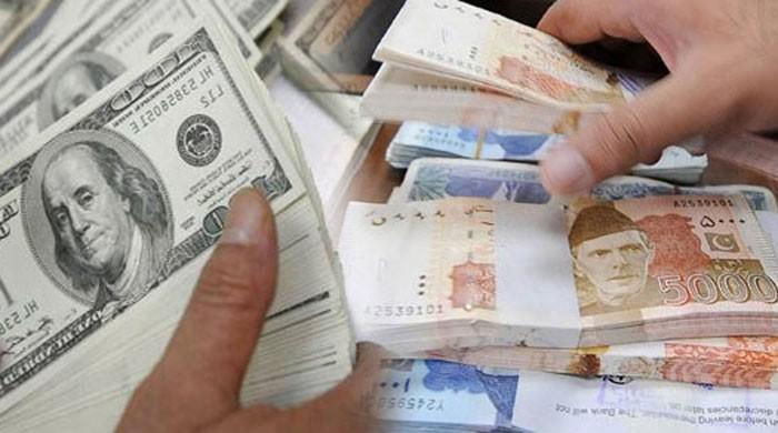 Devaluation weakens rupee to record low