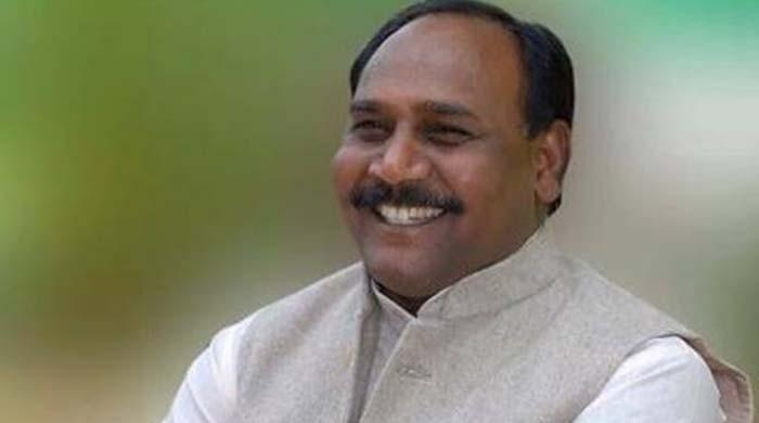 India 'happiness minister' wanted over alleged murder link