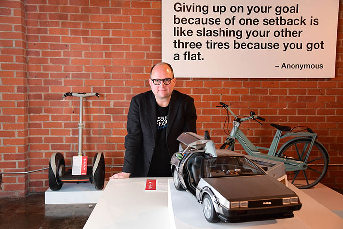 Dr Samuel West, the curator of The Museum of Failure poses among some of the museum´s displays including a plastic bicycle, a DeLorean car and a Segway, in downtown Los Angeles, California, December 7, 2017 – AFP