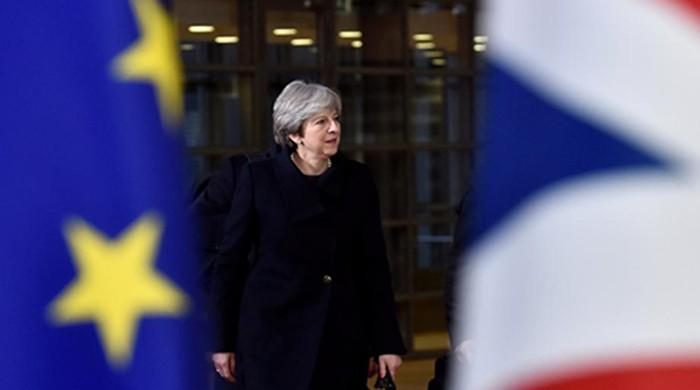 May wins applause from EU leaders for Brexit efforts