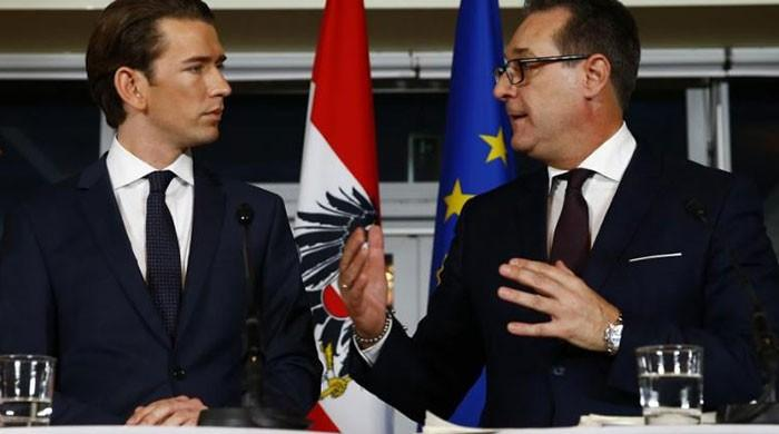 Austrian conservatives bring far right into government
