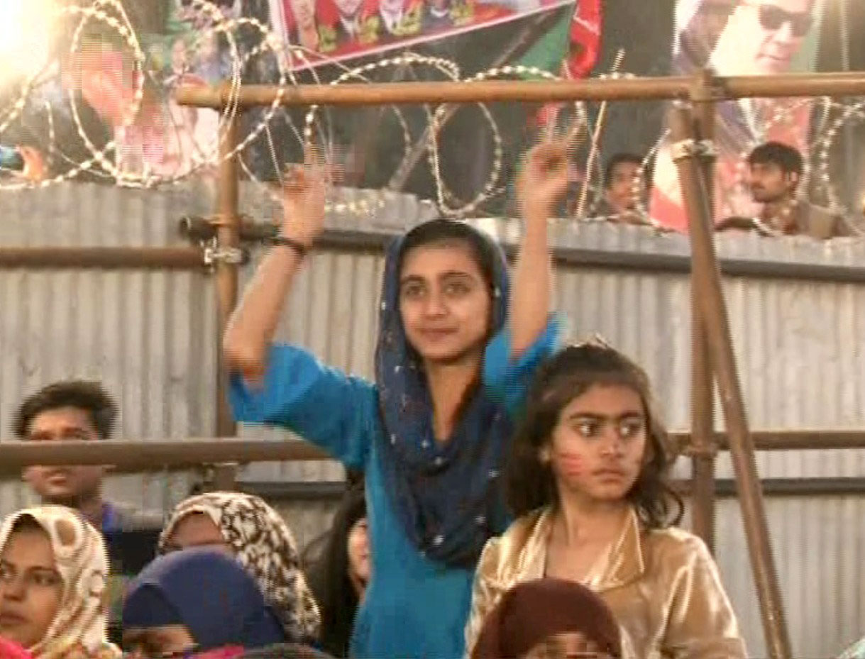 Pakistan Tehreek-e-Insaf (PTI) workers and supporters gathered at the venue of a party rally at the football ground in Okara on December 17, 2017