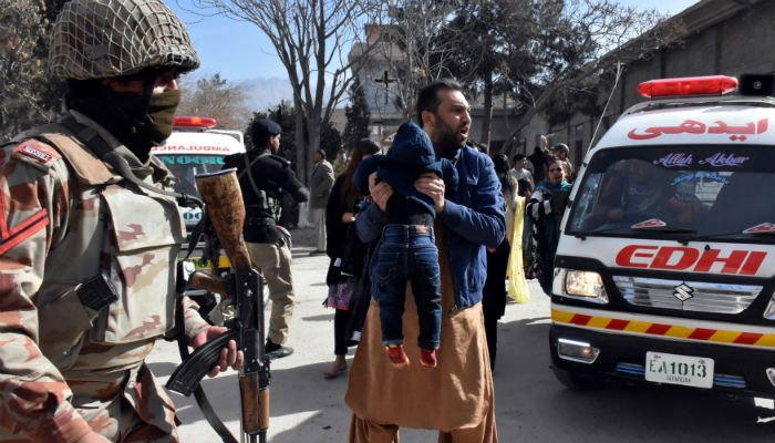 A man carries a boy as he shouts for an ambulance after gunmen attacked the Bethel Memorial Methodist Church in Quetta, Pakistan December 17, 2017. Photo: REUTERS