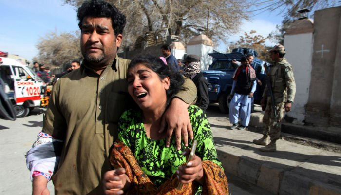 A man and a woman react as they run out after gunmen attacked the Bethel Memorial Methodist Church in Quetta, Pakistan December 17, 2017.  Photo: REUTERS