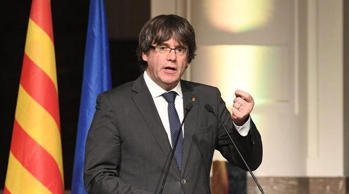 Spain must listen to voice of Catalan people, says exiled leader