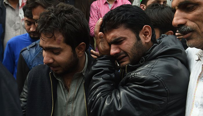 relatives mourn the death of a blast victim during a funeral ceremony in Lahore on February 14, 2017 - AFP