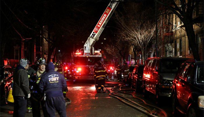 Four children among 12 killed in 'historic' NY apartment fire