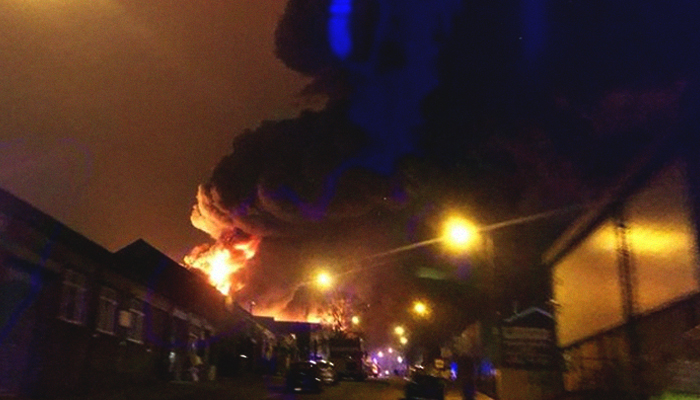 Huge blaze rips through warehouse in London as 90 firefighters tackle flames
