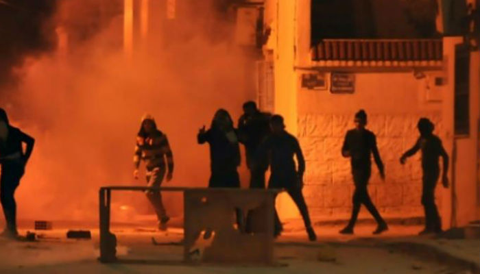 One person killed during protests in Tunisia