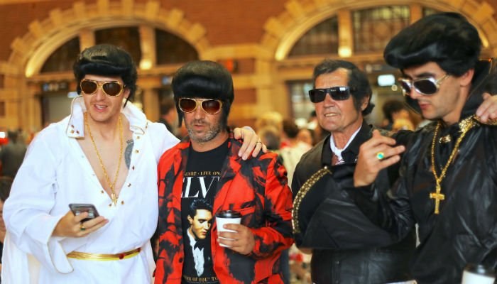 01036ac6db9 Elvis Presley impersonators stand together before boarding the Elvis  Express train at Sydney´s Central station before it departs for the 26th  annual Elvis ...
