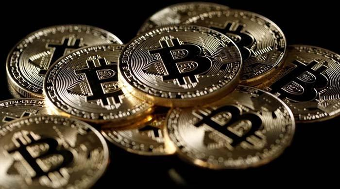 Bitcoin slides 14 percent on crackdown fears, hits four-week low