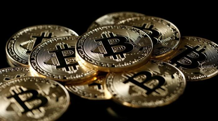 Bitcoin slides 18 percent on crackdown fears; crypto rivals also plunge