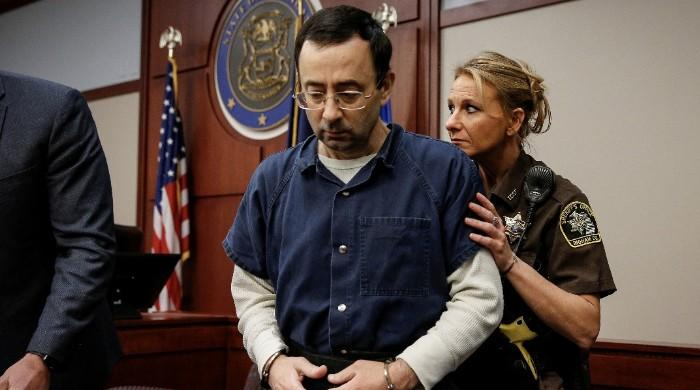Coach tells ex-USA gymnastics doctor Nassar in court to 'go to hell'