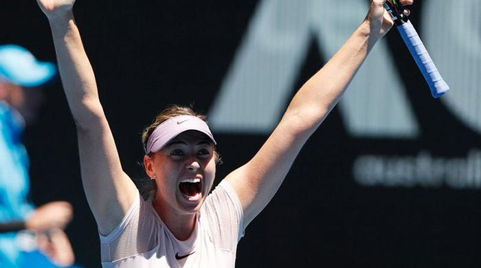 Sharapova storms into third round to set up Kerber clash