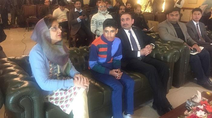 Pakistan reunites Afghan boy with family
