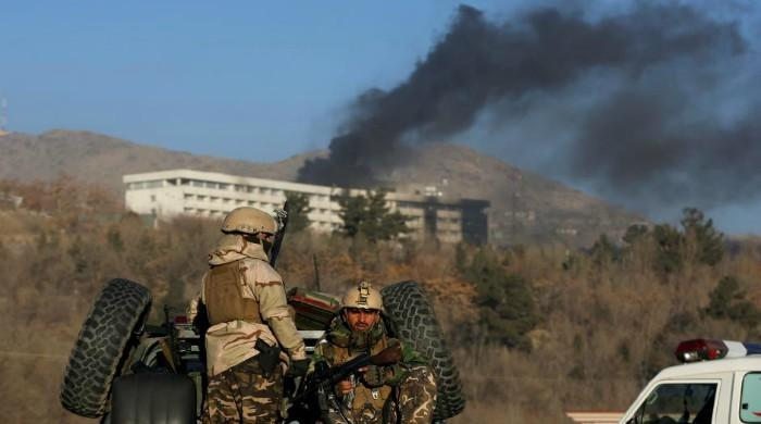At least 30 dead in overnight battle at Kabul hotel