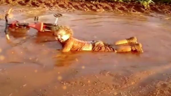 Child playing in mud puddle will make your day