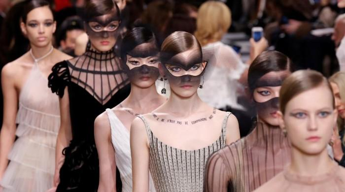 With swirls and cages, Dior goes surrealist for Haute Couture week
