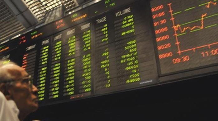 PSX 100 index turns red on current account blues
