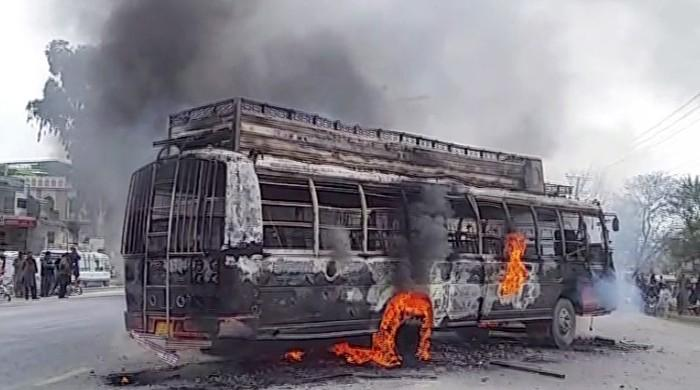 Protesters set buses ablaze after death of student in Gujar Khan