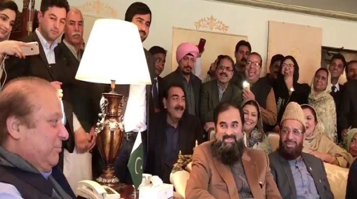 Nawaz, PML-N workers share a lighter moment in Islamabad meeting