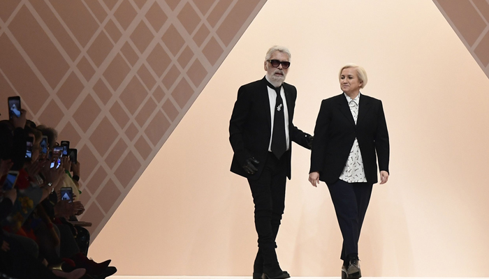 b19a6042b02b Karl Lagerfeld (L) and Silvia Venturini Fendi — Fashion designers for Fendi  — acknowledge the audience at the end of the women s Fall Winter 2018 2019  ...